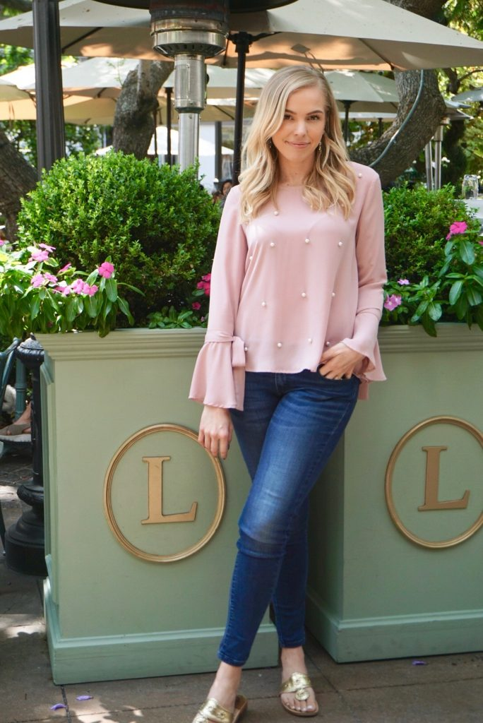 @blushinginhollywood wearing a long bell tie sleeve blush pink top with pearl beading at Laduree in Los Angeles