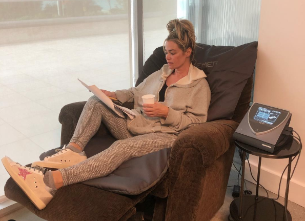Denise Richards actress and star of of Real Housewives of Beverly Hills using the Bemer Mat Vascular Healing Device. Photo from Instagram @deniserichards
